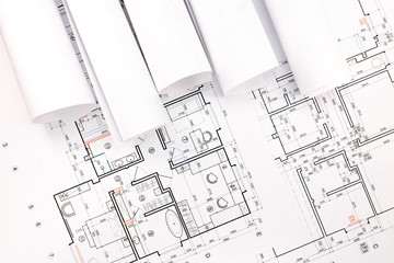 rolls of architecture blueprints and house plan