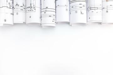 architectural blueprint rolls on white background