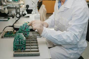 Microchip production factory. Computer expert