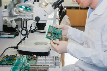 Microchip production factory. Computer expert