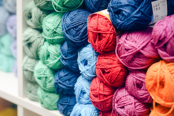 Colorful balls of wool piled up on shelf