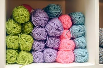 Knitting yarn on shelf, photo closeup