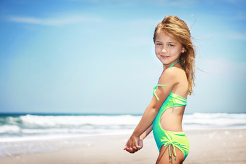 Cute little girl on a beach