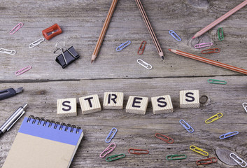 Text: Stress from wooden letters on wooden background