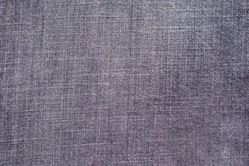 textured background from denim of pale violet color