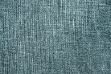 textured background from denim of pale indigo color