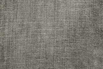 textured background from denim of pale beige color
