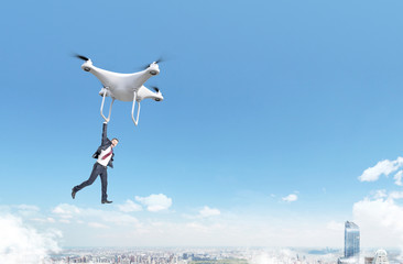 Businessman flying with quadrocopter