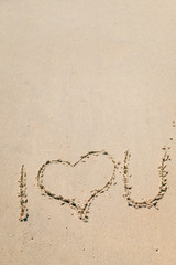 I love you draw on the outside sand beach background