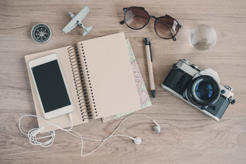 Outfit of traveler on wooden background with copy space