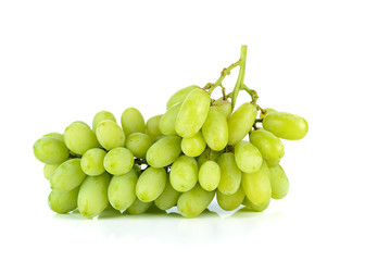 bunch of ripe and juicy green grapes close-up on a white backgro