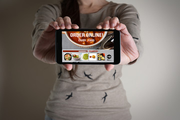 woman hand holding mobile with order food online.