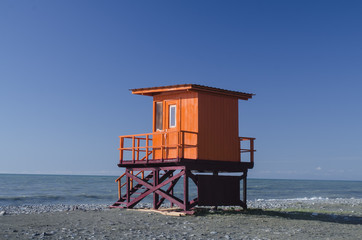 wooden lifeguard hut on an empty morning beach