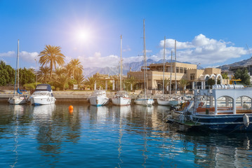 Yachts and ships in marina of Aqaba, Jordan southernmost city, popular resort, located at the northern tip of the Red Sea