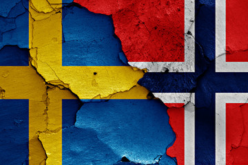 flags of Sweden and Norway painted on cracked wall