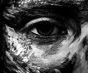 Black-white close-up fine art portrait of woman painted face part.
