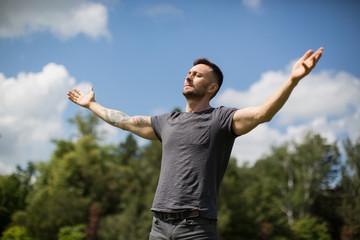 meditating man relaxing under the sun