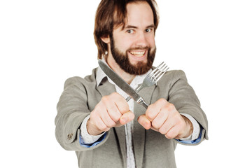 beard man holding cutlery fork and knife on hand.