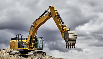 Constuction industry excavator heavy equipment on mountain
