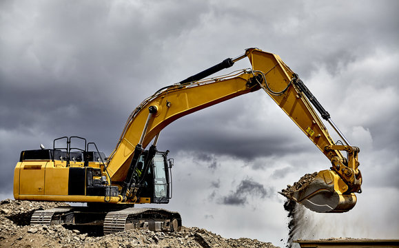 Constuction industry heavy equipment excavator loading gravel