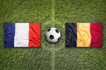 France vs. Belgium flags on soccer field