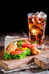 Closeup of tasty kebab with chicken and vegetables