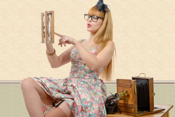 sexy pin up girl with old wood photo camera