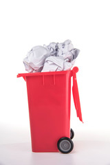 red garbage figure with crumpled paper ball
