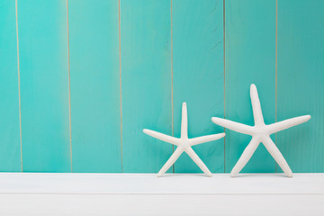 Starfish on a blue wooden background