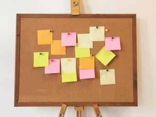A To Do List with post it paper on cork notice board