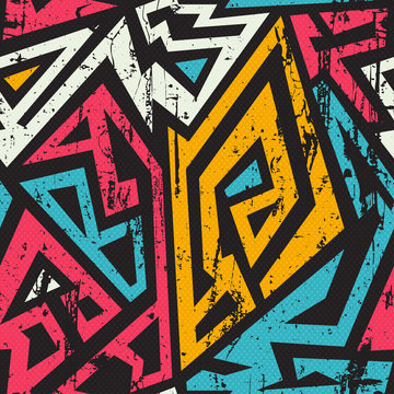 African geometric seamless with grunge effect.