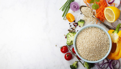 Bowl of healthy white quinoa seeds with vegetables