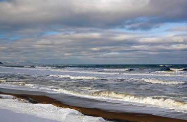Winter sea shore, snow on the sand