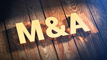 Acronym M&A on wood planks