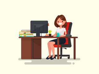 Business woman at work. Office worker woman behind the a work desktop
