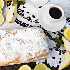 pie, strudel with pear and lemon. Cup of coffee. .Picnic, Breakfast in nature. Food in nature.
