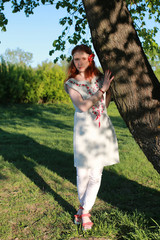 Girl hippie near tree
