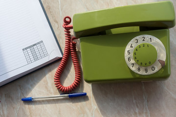 landline phone with a notebook