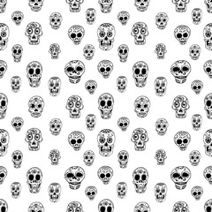 Seamless pattern with sugar skulls. Design element in vector.