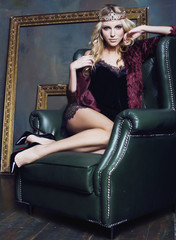 young blond woman wearing crown in fairy luxury interior with empty antique frames total wealth sexual