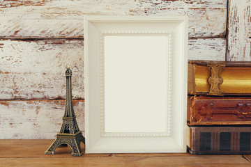 image of blank wooden frame, next to old books