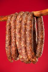 hanging smoked domestic trditional sausage