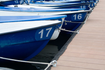 The boats on the boat parking fastened by the rope composition