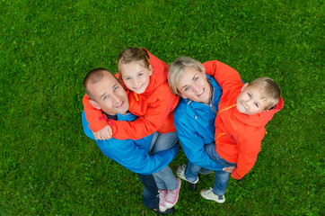portrait happy family in colorful clothes top view