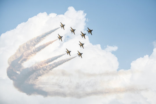 Show of force jets, planes carry a figure on a background of clouds, wallpaper with airplanes, jets is rotated in the sky