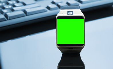 smartwatch near computer pc keyboard and mouse with chroma key green screen