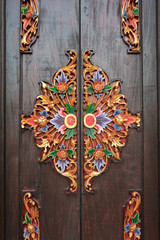Details of wooden ornate entrance door to temple In Bali. Indone