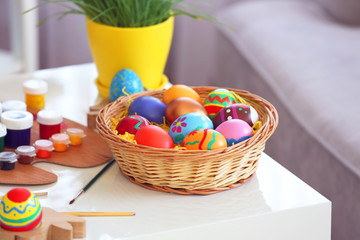 Easter eggs with paints on wooden table, indoors