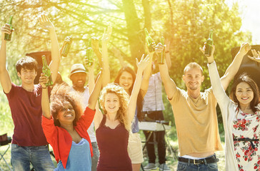 Multiracial young friends dancing in garden party with deejay in