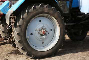 Wheel of a blue tractor, close up